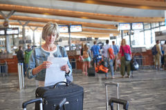 Woman with backpack going on boarding Stock Image
