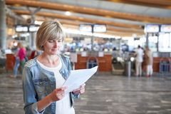Woman with backpack going on boarding Stock Images