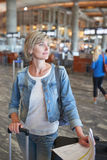 Woman with backpack going on boarding Royalty Free Stock Image