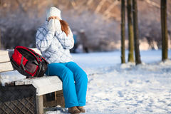 Woman with backpack heats hands in mittens at winter, copyspace Stock Photography