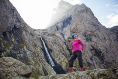 Woman with backpack is hiking. In Caucasus mountains in Georga Stock Photography