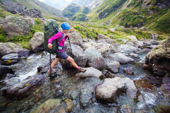 Woman with backpack is hiking in Caucasus mountains. In Georga Royalty Free Stock Photo