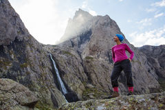 Woman with backpack is hiking in Caucasus mountains Stock Images