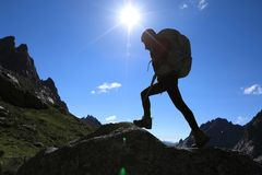 Woman hiking in mountains. Woman with backpack hiking in mountains travel lfestyle success concept Royalty Free Stock Photo
