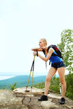 Woman with backpack hiking in the mountains Stock Photo
