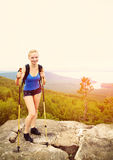 Woman with backpack hiking in the mountains Stock Image