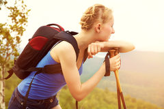 Woman with backpack hiking in the mountains Royalty Free Stock Photography