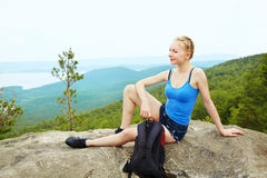 Woman with backpack hiking in the mountains. Young woman with backpack hiking in the mountains. people outdoors. healthy lifestyle Royalty Free Stock Photography