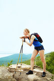 Woman with backpack hiking in the mountains Royalty Free Stock Image