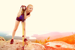 Woman with backpack hiking in the mountains Royalty Free Stock Photos