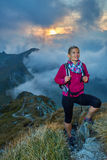Woman with backpack in the mountains Stock Photo