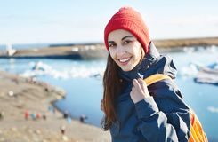 Woman with backpack in Ice Lagoon in Iceland Royalty Free Stock Photography