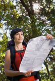 Woman with backpack and map Stock Photography