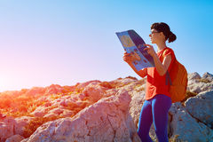 Woman with backpack and map Royalty Free Stock Image