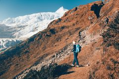 Woman with backpack on the mountain trail Royalty Free Stock Image