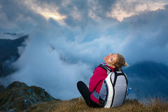 Woman with backpack in the mountains Royalty Free Stock Photography
