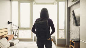 Woman with backpack ready to travel. Asian woman in a room with backpack ready to travel Stock Photo