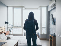 Woman with backpack ready to travel. Asian woman in a room with backpack ready to travel Royalty Free Stock Images
