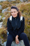 Woman with backpack resting Royalty Free Stock Photos