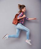 Woman with backpack running Stock Photos