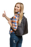 Woman with backpack showing thumb up Stock Photos