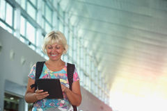 Woman with a backpack and a tablet pc in the hands Royalty Free Stock Photography