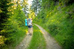 Woman with a backpack on the trail Stock Image
