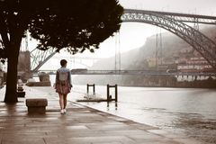Woman with backpack travelling in Portugal stock photography
