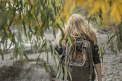 Woman with backpack in trees
