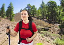 Woman with backpack on a trekking Stock Image