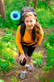 Woman with a backpack up the hill Royalty Free Stock Photo