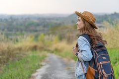 Woman with backpack walking on footpath in nature. Woman with backpack walking on footpath in the nature stock photography