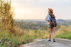 Woman with backpack walking on footpath in nature. Woman with backpack walking on footpath in the nature royalty free stock photography