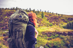 Woman with backpack watching fellow hillwalkers in the distance Stock Photography