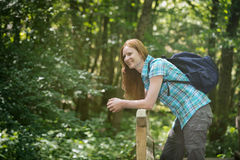 Woman with a Backpack in a Wood Royalty Free Stock Photos