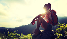 Woman backpacker enjoy the view at mountain peak Royalty Free Stock Photo