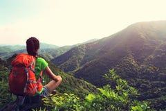 Woman backpacker enjoy the view at mountain peak Stock Photos