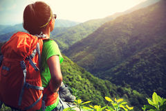 Woman backpacker enjoy the view at mountain peak Royalty Free Stock Photography