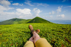 Woman backpacker enjoy the view on summer mountains Royalty Free Stock Images