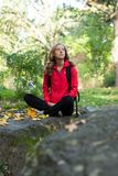 Woman backpacker enjoying relaxation in the forest Stock Photos