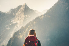 Woman backpacker enjoying rocky mountains view Royalty Free Stock Image