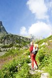 Woman backpacker in High Tatras Royalty Free Stock Photos