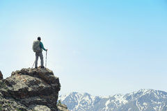 woman backpacker hiking on mountain peak Royalty Free Stock Image