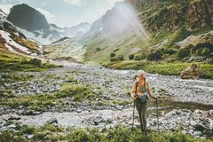 Woman backpacker hiking in mountains adventure. Travel lifestyle concept active summer vacations sport outdoor Stock Photography