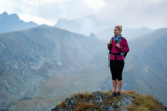 Woman backpacker hiking on a trail Stock Photography