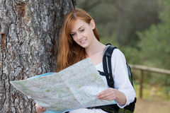Woman backpacker with a map Royalty Free Stock Photos