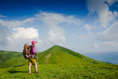 Woman backpacker in the mountains enjoy the view Stock Photo