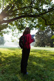 Woman backpacker read the map among the ature Stock Images