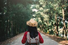 Woman backpacker in the road and forest background. Relax time on holiday concept travel ,color of vintage tone and soft focus Stock Images