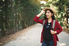 Woman backpacker in the road and forest background. Relax time on holiday concept travel ,color of vintage tone and soft focus Stock Image